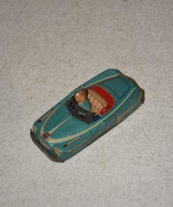 Madamvintage - lichtblauwe auto met persoon